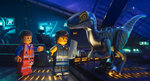 This image released by Warner Bros. Pictures shows the characters Emmet, left, and Rex Dangervest, center, both voiced by Chris Pratt, in a scene from
