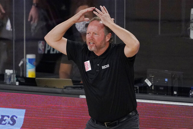 Milwaukee Bucks head coach Mike Budenholzer shouts in the second half of an NBA conference semifinal playoff basketball game against the Miami Heat Tuesday, Sept. 8, 2020 in Lake Buena Vista, Fla. (AP Photo/Mark J. Terrill)