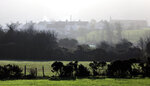 FILE - In this file photo dated Thursday, Nov. 15, 2018,  a view of houses in the village of Jonesborough on the Irish border between Northern Ireland and the Irish Republic close to the town of Newry, Northern Ireland.  The hope of Britain's Brexit split from the European Union depends on finding a political solution to avoid having a hard border across the peaceful green fields that span the seamless border dividing Northern Ireland from the Republic of Ireland. (AP Photo/Peter Morrison, FILE)