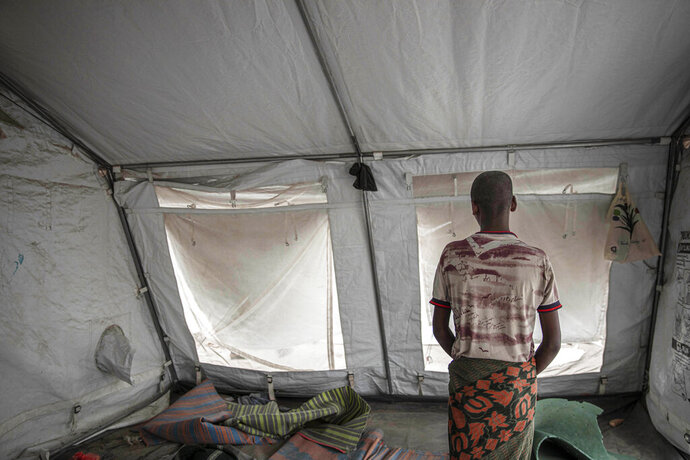 In this July 21, 2019 photo, 15-year-old Nogos stands in a tent at the