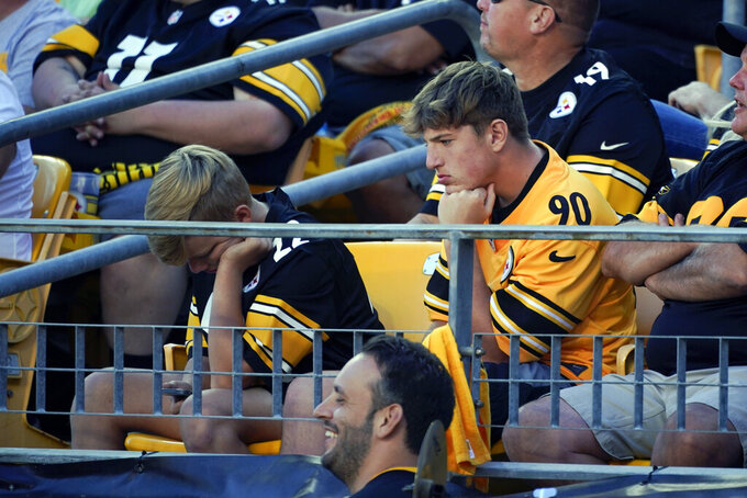 Pittsburgh Steelers fans sit in the stands as their team is losing to the Cincinnati Bengals during the second half an NFL football game, Sunday, Sept. 26, 2021, in Pittsburgh. The Bengals won 24-10. (AP Photo/Gene J. Puskar)