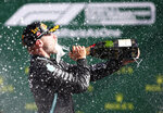 Mercedes driver Valtteri Bottas of Finland sprays champagne after winning the Austrian Formula One Grand Prix at the Red Bull Ring racetrack in Spielberg, Austria, Sunday, July 5, 2020. (Mark Thompson/Pool via AP)