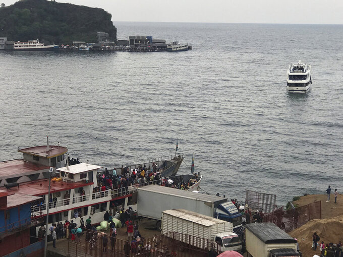 Residents leave Goma, Congo, by boat on Lake Kivu Thursday, May 27, 2021, five days after Mount Nyiragongo erupted. Evacuation orders were given for most of the town, fearing further eruptions and tremors. (AP Photo/Moses Sawasawa)