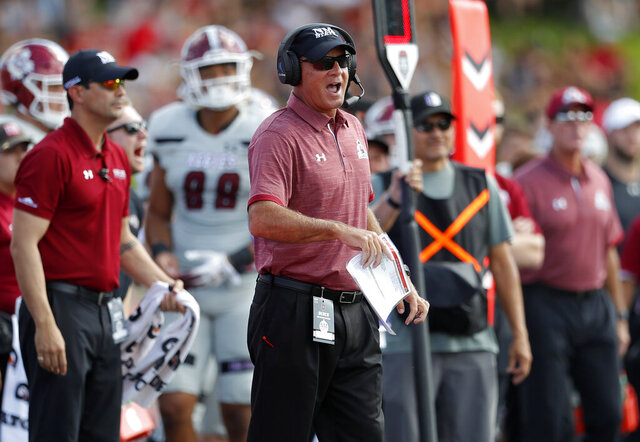 FILE - In this Sept. 21, 2019, file photo, New Mexico State coach Doug Martin reacts on the sideline during the first half of the team's NCAA college football game against New Mexico in Albuquerque, N.M. New Mexico Attorney General Hector Balderas demanded Thursday, May 14, 2020, that New Mexico State turn over documents related to an investigation into Martin over allegations of abuse. (AP Photo/Andres Leighton, File)