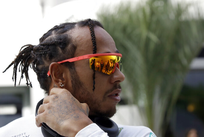 Mercedes driver Lewis Hamilton of Britain walks through the paddock prior to the start of the first free practice at the 'Sochi Autodrom' Formula One circuit, in Sochi, Russia, Friday, Sept. 27, 2019. The Formula one race will be held on Sunday. (AP Photo/Luca Bruno)