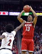North Carolina State guard C.J. Bryce (13) shoots over Louisville guard Darius Perry (2) during the first half of an NCAA college basketball game in Louisville, Ky., Thursday, Jan. 24, 2019. (AP Photo/Timothy D. Easley)