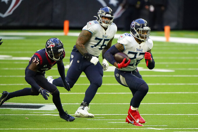 Tennessee Titans running back Derrick Henry (22) runs for a touchdown as Houston Texans safety A.J. Moore Jr. (33) defends during the first half of an NFL football game Sunday, Jan. 3, 2021, in Houston. (AP Photo/Eric Christian Smith)