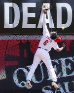 Cincinnati Reds right fielder Phillip Ervin (6) misses a triple hit by Philadelphia Phillies' J.T. Realmuto off starting pitcher Sonny Gray in the fourth inning of a baseball game, Thursday, Sept. 5, 2019, in Cincinnati. (AP Photo/John Minchillo)