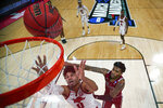 Arkansas' Justin Smith (0) fights for a rebound with Colgate's Jordan Burns, right, during a first-round men's college basketball game in the NCAA Tournament, Friday, March 19, 2021, at Bankers Life Fieldhouse in Indianapolis. (Jack Dempsey/Pool Photo via AP)