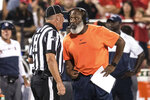 Illinois head coach Lovie Smith speaks with an official during a timeout in the first half of an NCAA college football game against Nebraska, Saturday, Sept. 21, 2019, in Champaign, Ill. (AP Photo/Holly Hart)