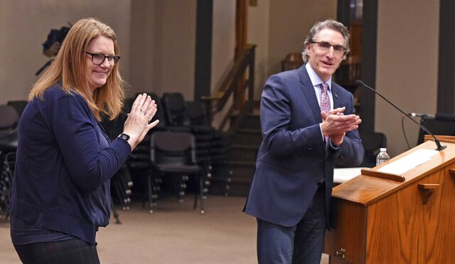 North Dakota Gov. Doug Burgum leads a round of applause after recognizing sign language interpreter Lindsey Solberg Herbel during a recent COVID-19 briefing at the state Capitol in Bismarck, N.D. (Tom Stromme/The Bismarck Tribune via AP)