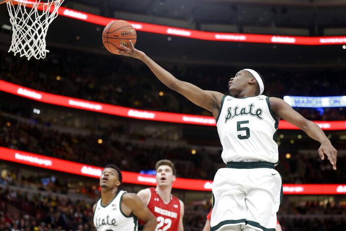 Michigan State's Cassius Winston (5) goes up for a lay up during the first half of an NCAA college basketball game against Wisconsin in the semifinals of the Big Ten Conference tournament, Saturday, March 16, 2019, in Chicago. (AP Photo/Kiichiro Sato)
