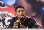 British boxer Anthony Joshua speaks during a news conference, Tuesday, Feb. 19, 2019, in New York, to promote their upcoming fight against Jarrell Miller. (AP Photo/Frank Franklin II)
