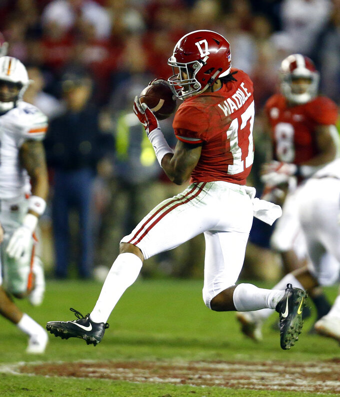 Alabama wide receiver Jaylen Waddle (17) catches a pass and thens carries it in for a touchdown against Auburn during the second half of an NCAA college football game Saturday, Nov. 24, 2018, in Tuscaloosa, Ala. Alabama won 52-21. (AP Photo/Butch Dill)
