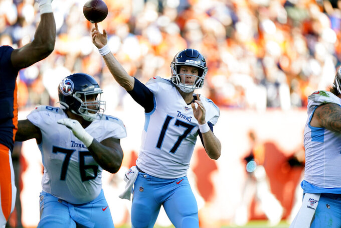 Tennessee Titans quarterback Ryan Tannehill (17) throws a pass during the second half of an NFL football game against the Denver Broncos, Sunday, Oct. 13, 2019, in Denver. (AP Photo/Jack Dempsey)