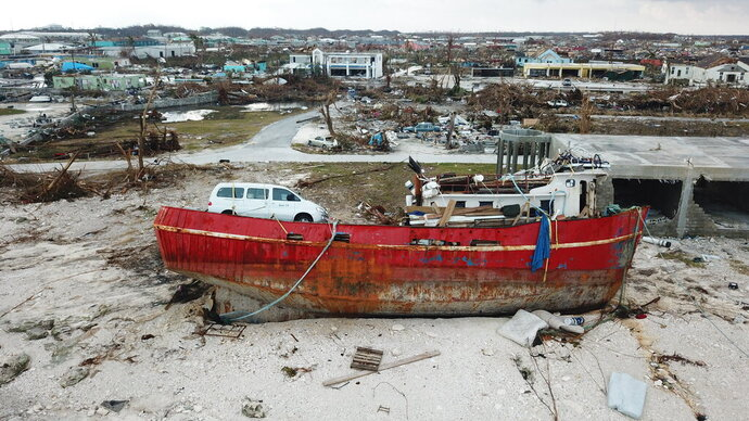 A boat sits grounded in the aftermath of Hurricane Dorian, in Marsh Harbor, Abaco Island, Bahamas, Friday, Sept. 6, 2019. The Bahamian health ministry said helicopters and boats are on the way to help people in affected areas, though officials warned of delays because of severe flooding and limited access. (AP Photo/Gonzalo Gaudenzi)