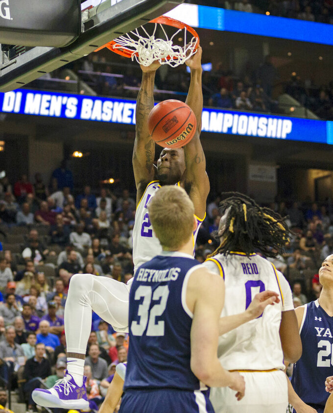 LSU forward Emmitt Williams (24) dunks the ball during the second half of the first round men's college basketball game against Yale in the NCAA Tournament in Jacksonville, Fla., Thursday, March 21, 2019. (AP Photo/Stephen B. Morton)