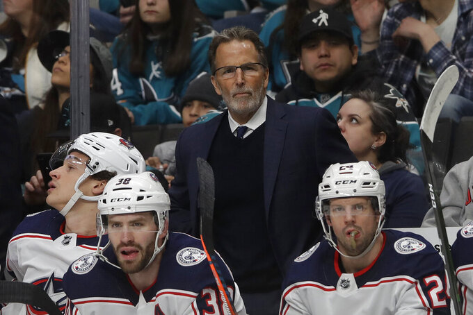 FILE - In this Jan. 9, 2020, file photo, Columbus Blue Jackets head coach John Tortorella, center, looks on during an NHL hockey game against the San Jose Sharks in San Jose, Calif. Tortorella is out as coach of the Columbus Blue Jackets after six seasons. (AP Photo/Jeff Chiu, File)