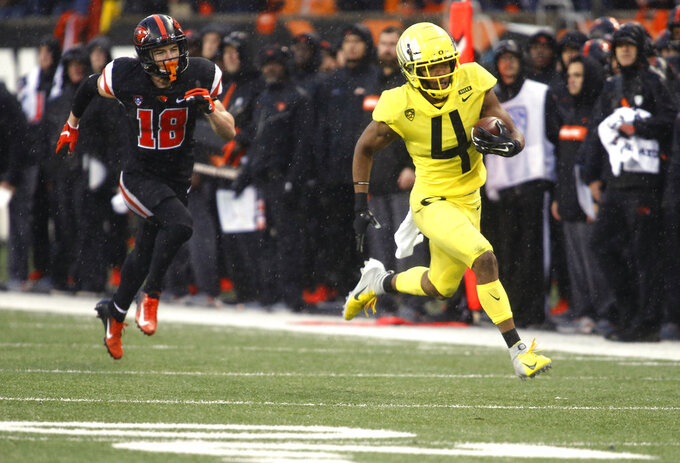 Oregon cornerback Thomas Graham Jr. (4) pulls away from Oregon State wide receiver Timmy Hernandez (18) on an interception return for a touchdown during the second half of an NCAA college football game in Corvallis, Ore., Friday, Nov. 23, 2018. Oregon won 55-15. (AP Photo/Timothy J. Gonzalez)