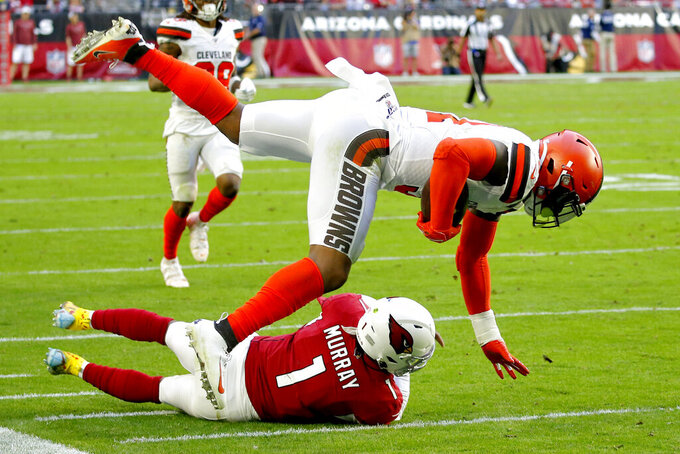 Cleveland Browns linebacker Mack Wilson is tackled by Arizona Cardinals quarterback Kyler Murray (1) after intercepting a pass during the first half of an NFL football game, Sunday, Dec. 15, 2019, in Glendale, Ariz. (AP Photo/Ross D. Franklin)