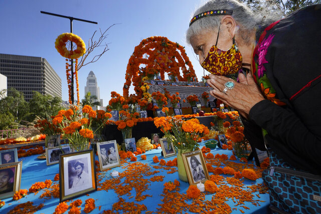 Ofelia Esparza, 88, from East Los Angles, has brough fresh marigolds, often called