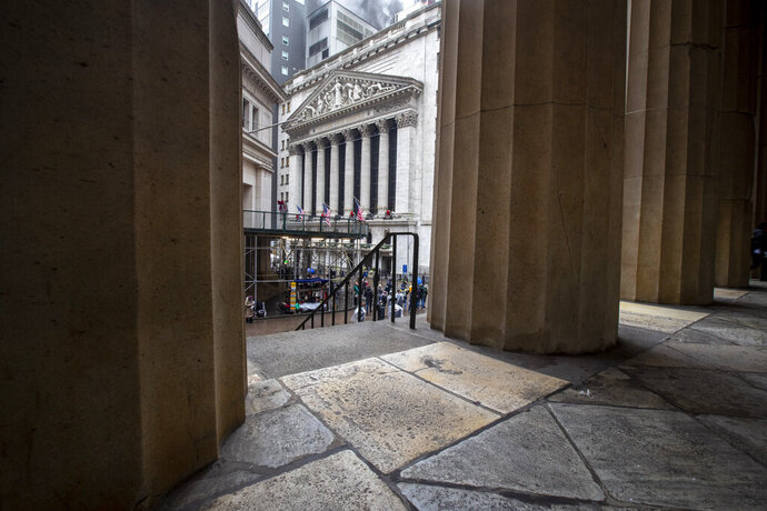 FILE - In this Jan. 3, 2020, file photo the New York Stock Exchange is framed by the columns at Federal Hall National Memorial in New York. The U.S. stock market opens at 9:30 a.m. EST on Friday, Jan. 10. (AP Photo/Mary Altaffer, File)