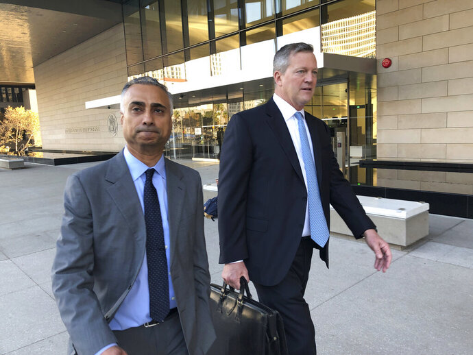 """FILE - In this Nov. 22, 2019 file photo, Imaad Zuberi, left, leaves the federal courthouse in Los Angeles with his attorney Thomas O'Brien, right, after pleading guilty to funneling donations from foreigners to U.S. political campaigns.  Zuberi, an elite political fundraiser, had the ear of top Democrats and Republicans alike — a reach that included private meetings with then-Vice President Joe Biden and VIP access at Donald Trump's inauguration. But federal prosecutors say Zuberi's life was built on a series of lies and the lucrative enterprise of filling the campaign coffers of American politicians and profiting from the resulting influence. They describe him as a """"mercenary"""" political donor who gave to anyone -- often using foreign money given through illegal straw donors. (AP Photo/Brian Melley, File)"""