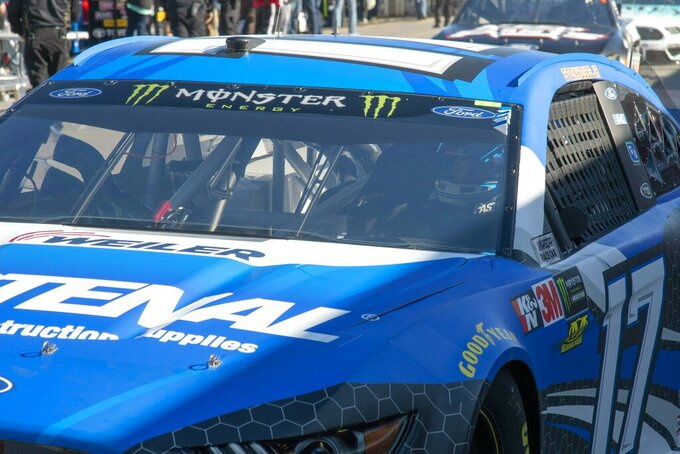 Ricky Stenhouse Jr. passes through the garage area during practice for the NASCAR Monster Energy Cup Series race at Martinsville Speedway in Martinsville, Va., Saturday, March 23, 2019. (AP Photo/Matt Bell)
