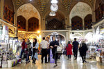People shop at the old main bazaar in Tehran, Iran, Sunday, June 23, 2019. The most-visible place to see the effect of the economic hardship most face comes from walking by any money-exchange shop. Depreciation and inflation makes everything more expensive, from fruits and vegetables to tires and oil all the way to the big-ticket items, like mobile phones. (AP Photo/Ebrahim Noroozi)