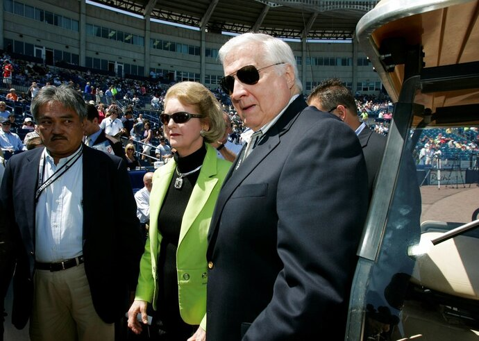 FILE - In this March 27, 2008, file photo, Joan Steinbrenner and her husband, New York Yankees principal owner George Steinbrenner, arrive for a pre-game ceremony renaming Legends Field as George M. Steinbrenner Field, in Tampa, Fla. Joan Steinbrenner, the widow of late New York Yankees owner George Steinbrenner, passed away Friday, Dec. 14, 2018 at her home in Tampa, Fla. She was 83. (AP Photo/Kathy Willens, File)