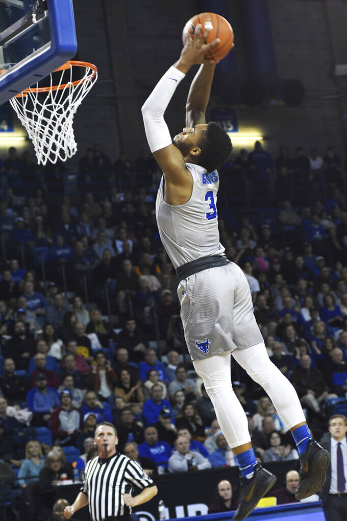 Buffalo's Jayvon Graves goes for a slam dunk against Central Michigan during an NCAA college basketball game in Buffalo, N.Y., Saturday, Feb. 9, 2019. (AP Photo/Heather Ainsworth)