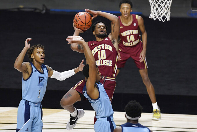 Boston College's Wynston Tabbs (10) is fouled by Rhode Island's Jeremy Sheppard, bottom center, in the first half of an NCAA college basketball game, Thursday, Nov. 26, 2020, in Uncasville, Conn. (AP Photo/Jessica Hill)