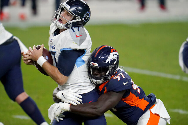 Tennessee Titans quarterback Ryan Tannehill (17) is sacked by Denver Broncos linebacker Jeremiah Attaochu (97) during the first half of an NFL football game, Monday, Sept. 14, 2020, in Denver. (AP Photo/David Zalubowski)