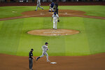 Houston Astros' Alex Bregman (2) rounds second base after hitting a two-run home run off Texas Rangers' pitcher Lance Lynn in the fifth inning of a baseball game in Arlington, Texas, Thursday, Sept. 24, 2020. (AP Photo/Tony Gutierrez)