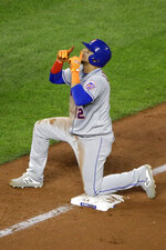 New York Mets' Juan Lagares celebrates on third base after hitting an RBI triple during the eighth inning of the team's baseball game against the Kansas City Royals on Saturday, Aug. 17, 2019, in Kansas City, Mo. (AP Photo/Charlie Riedel)