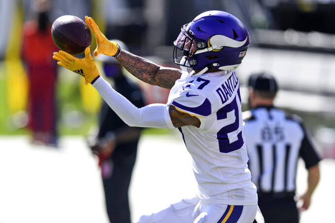 FILE - In this Dec. 13, 2020, file photo, Minnesota Vikings cornerback Cameron Dantzler (27) makes a catch before an NFL football game against the Tampa Bay Buccaneers in Tampa, Fla. The Vikings will be without their best cornerback, Patrick Peterson, for a daunting matchup for their defense against the highest-scoring team in the NFL, the Dallas Cowboys. Cameron Dantzler will take his place in the starting lineup. (AP Photo/Jason Behnken, File)