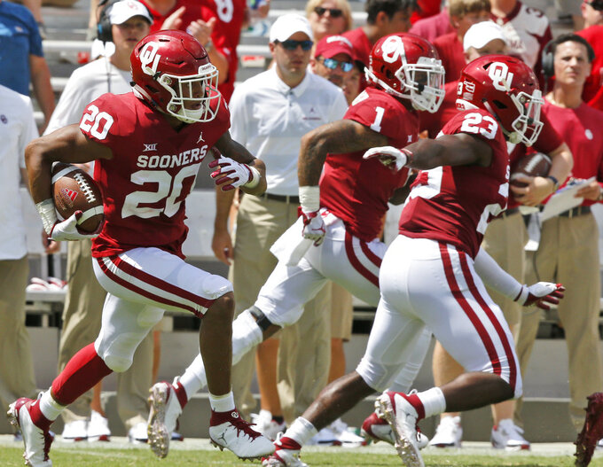 Oklahoma safety Robert Barnes (20) returns an interception 32-yards in the second half of an NCAA college football game against Florida Atlantic in Norman, Okla., Saturday, Sept. 1, 2018. (AP Photo/Sue Ogrocki)