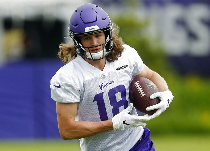 FILE - In this May 29, 2019, file photo, Minnesota Vikings wide receive Jordan Taylor carries the ball during workouts for the NFL football team in Eagan, Minn. Taylor, Chad Beebe, Laquon Treadwell and Brandon Zylstra are among the leading candidates to emerge as the No. 3 wide receiver for the Vikings. Even with stars Adam Thielen and Stefon Diggs established at that position, quarterback Kirk Cousins needs another go-to target. (AP Photo/Jim Mone, File)