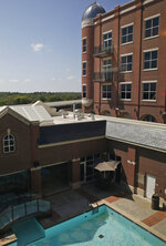 In this Sept. 17, 2019 photo, a swimming pool at the Artesian Hotel, Casino & Spa, a four-story hotel and spa, is pictured in Sulphur, Okla. In downtown Sulphur, 90 minutes south of Oklahoma City, the Chickasaw Nation built the hotel and spa that hosts prom night for half a dozen area high schools. (AP Photo/Sue Ogrocki)