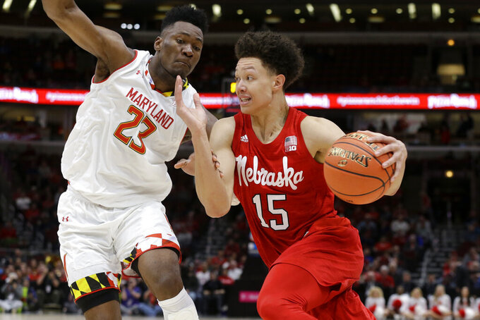 Nebraska's Isaiah Roby (15) drives against Maryland's Bruno Fernando (23) during the second half of an NCAA college basketball game in the second round of the Big Ten Conference tournament, Thursday, March 14, 2019, in Chicago. (AP Photo/Kiichiro Sato)