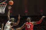 Illinois' Kofi Cockburn (21) goes to the basket as Rutgers' Shaq Carter (13) defends in the first half of an NCAA college basketball game, Sunday, Jan. 11, 2020, in Champaign, Ill. (AP Photo/Holly Hart)
