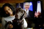 Alicia Barnett sits with her Chocolate Labrador Retriever named