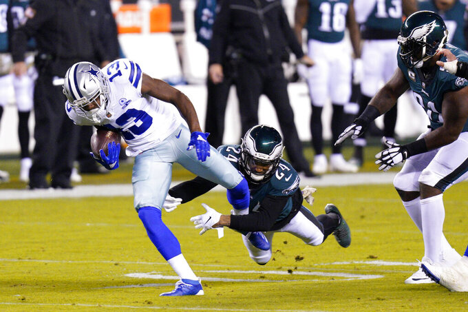 Dallas Cowboys' Michael Gallup (13) tries to get past Philadelphia Eagles' Darius Slay (24) during the first half of an NFL football game, Sunday, Nov. 1, 2020, in Philadelphia. (AP Photo/Chris Szagola)