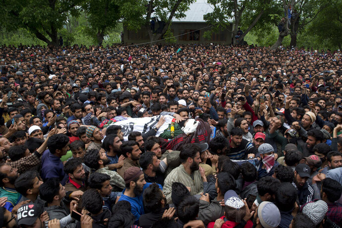 Kashmiri villagers carry body of top rebel commander Naseer Pandith, during his funeral procession in Pulwama, south of Srinagar, Indian controlled Kashmir, Thursday, May 16, 2019. Three rebels, an army soldier and a civilian were killed early Thursday during a gunbattle in disputed Kashmir that triggered anti-India protests and clashes, officials and residents said. (AP Photo/ Dar Yasin)