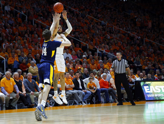 Tennessee guard Lamonte Turner (1) shoots over West Virginia guard Chase Harler (14) in the first half of an NCAA college basketball game Saturday, Jan. 26, 2019, in Knoxville, Tenn. (AP Photo/Wade Payne)