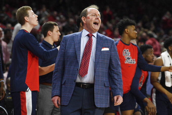 Mississippi coach Kermit Davis reacts to a call against Arkansas during an NCAA college basketball game, Saturday, March 2, 2019 in Fayetteville, Ark. (AP Photo/Michael Woods)
