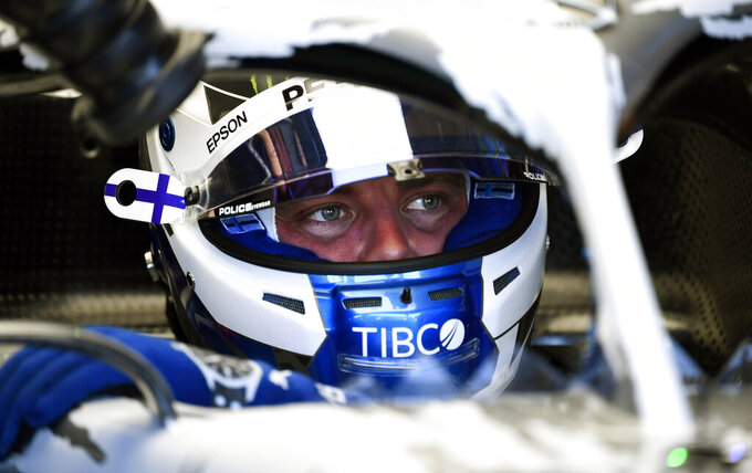 Mercedes driver Valtteri Bottas of Finland prepares for the first practice session at the Hockenheimring racetrack in Hockenheim, Germany, Friday, July 26, 2019. The German Formula One Grand Prix will be held on Sunday. (AP Photo/Jens Meyer)