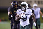 Michigan State running back Kenneth Walker III (9) runs for a touchdown past Northwestern safety Brandon Joseph (16) during the first half of an NCAA college football game in Evanston, Ill., Friday, Sept. 3, 2021. (AP Photo/Nam Y. Huh)