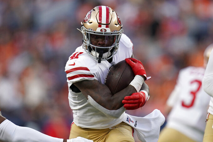 San Francisco 49ers Jeff Wilson Jr (41) runs against the Denver Broncos during an NFL preseason football game, Monday, Aug. 19, 2019, in Denver. (AP Photo/Jack Dempsey)