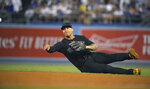 New York Yankees second baseman Gleyber Torres throws out Los Angeles Dodgers' Matt Beaty at first during the seventh inning of a baseball game Friday, Aug. 23, 2019, in Los Angeles. (AP Photo/Mark J. Terrill)